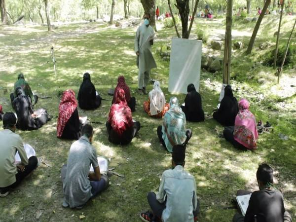 Students attending open-air community class in Anantnag (Photo/ANI)
