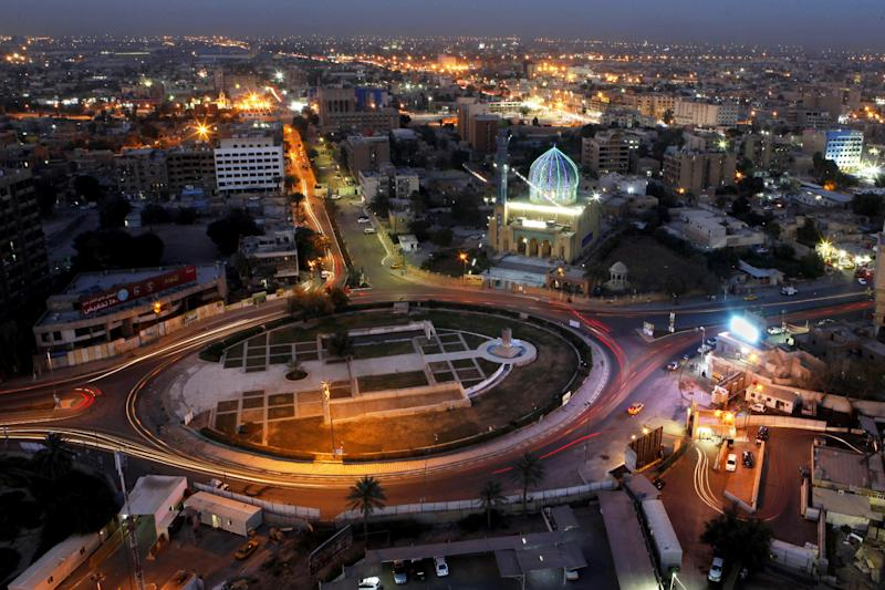 In this Sunday, April 7, 2013 photo, a general view of Firdous Square, where the statue of Saddam Hussein was pulled down by U.S. forces and Iraqis on April 9, 2003, in central Baghdad, Iraq. Ten years ago, a statue fell in Paradise Square. Joyful Iraqis helped by a U.S. Army tank retriever pulled down their longtime dictator, cast as 16 feet of bronze. The scene broadcast live worldwide became an icon for a war, a symbol of final victory over Saddam Hussein. But for the people of Baghdad, it was only the beginning. The toppling of the statue on April 9, 2003, remains a potent symbol that has divided Iraqis ever since.  (AP Photo/ Hadi Mizban)