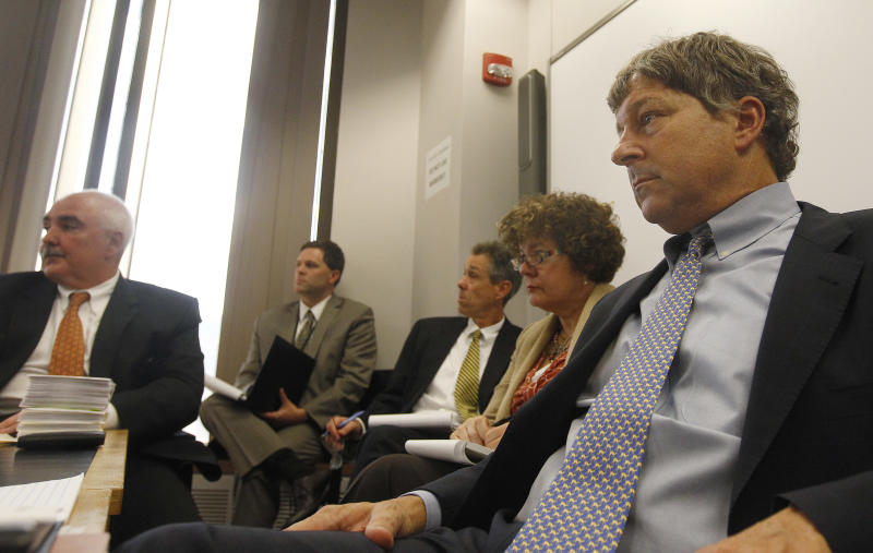 David Meier, right, special consul to the Governor appointed to lead the review of drug convictions which might have been compromised by a State Police drug testing lab, leads a meeting at the Department of Public Safety in Boston, Monday, Sept. 24, 2012. Prosecutors, defense attorney's along with representatives from the District Attorney's office, the U.S. Attorney's office, the State Police and the Department of Public Safety were in attendance.   (AP Photo/Stephan Savoia)