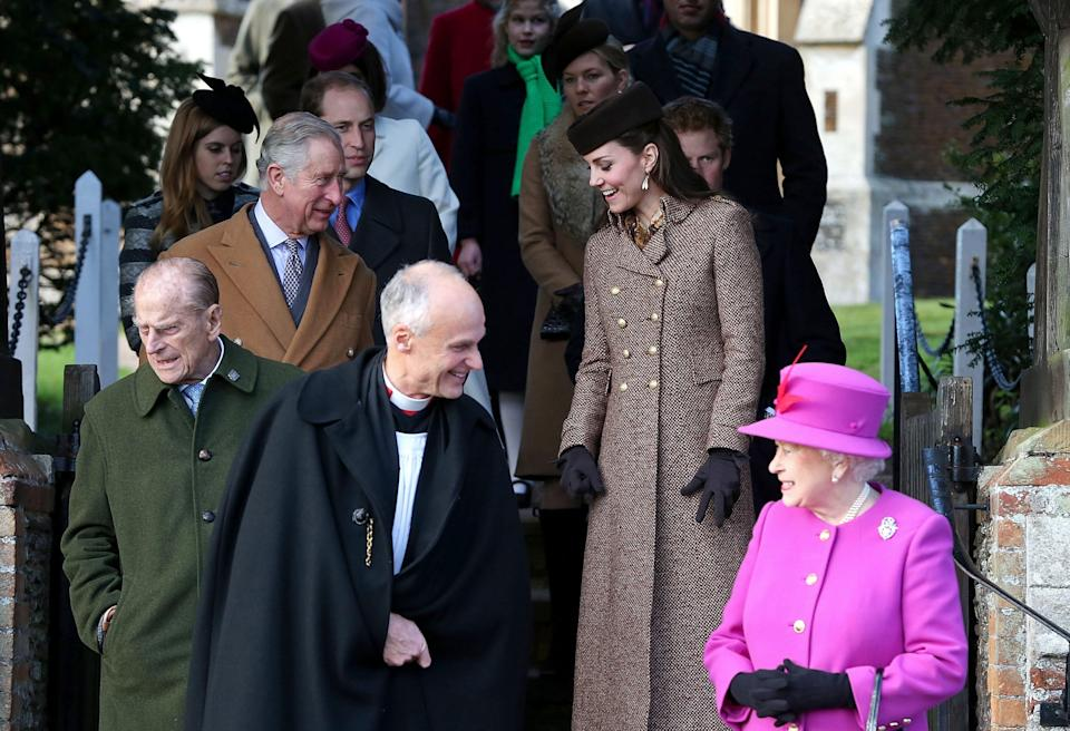 KING'S LYNN, ENGLAND - DECEMBER 25:  Queen Elizabeth II leaves church with Prince William, Duke of Cambridge, Catherine, Duchess of Cambridge, Prince Philip, Duke of Edinburgh, Prince Charles, Prince of Wales and Prince Harry during the Christmas Day church service at Sandringham on December 25, 2014 in King's Lynn, England.  (Photo by Danny Martindale/WireImage)