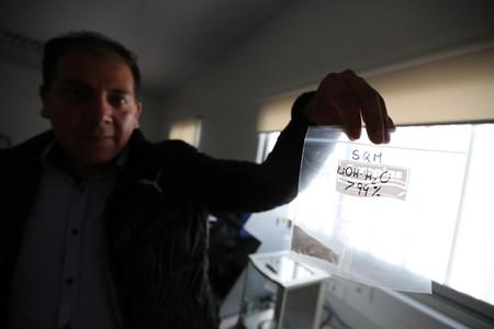 A bag with lithium inside is seen in a laboratory of the University of Antofagasta