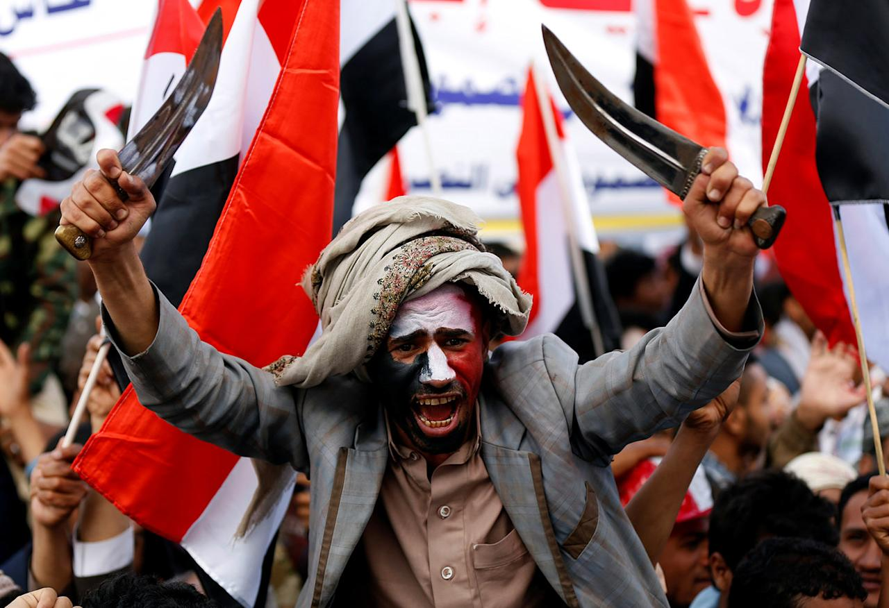 <p>A man waves traditional daggers, or Jambiyas, as he attends with supporters of the Houthi movement and Yemen's former president Ali Abdullah Saleh a rally to mark two years of the military intervention by the Saudi-led coalition, in Sanaa, Yemen March 26, 2017. (Photo: Khaled Abdullah/Reuters) </p>