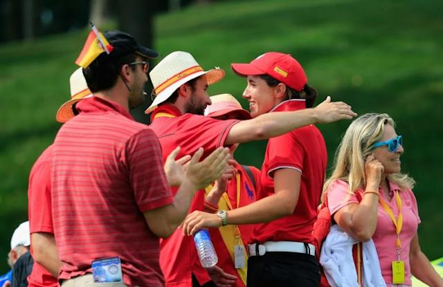 Spanish golfers and caddies celebrate winning the inaugural LPGA International Crown team event in 2014 at Caves Valley Golf Club, which will host the US PGA Tour's penultimate playoff event, the BMW Championship, in 2021 (AFP Photo/Rob Carr)