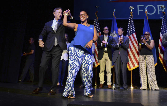 """<span class=""""s1"""">Connecticut gubernatorial candidate Ned Lamont dances with State Rep. Toni Walker as he celebrates his win in the Democratic primary in New Haven, Conn., Tuesday. (Photo: Jessica Hill/AP)</span>"""