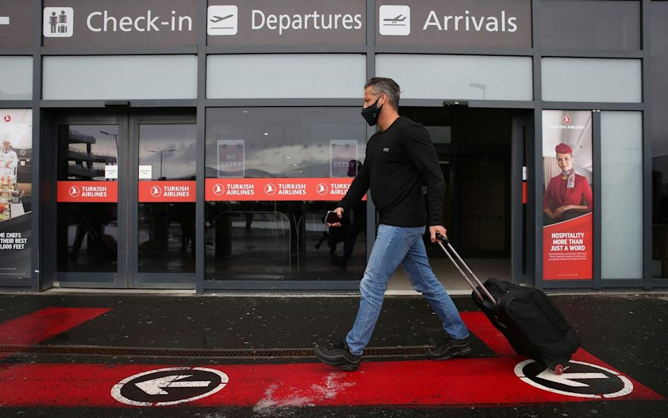 Passengers at Edinburgh airport, Scotland, ahead of new quarantine rules in Scotland - Andrew Milligan/PA
