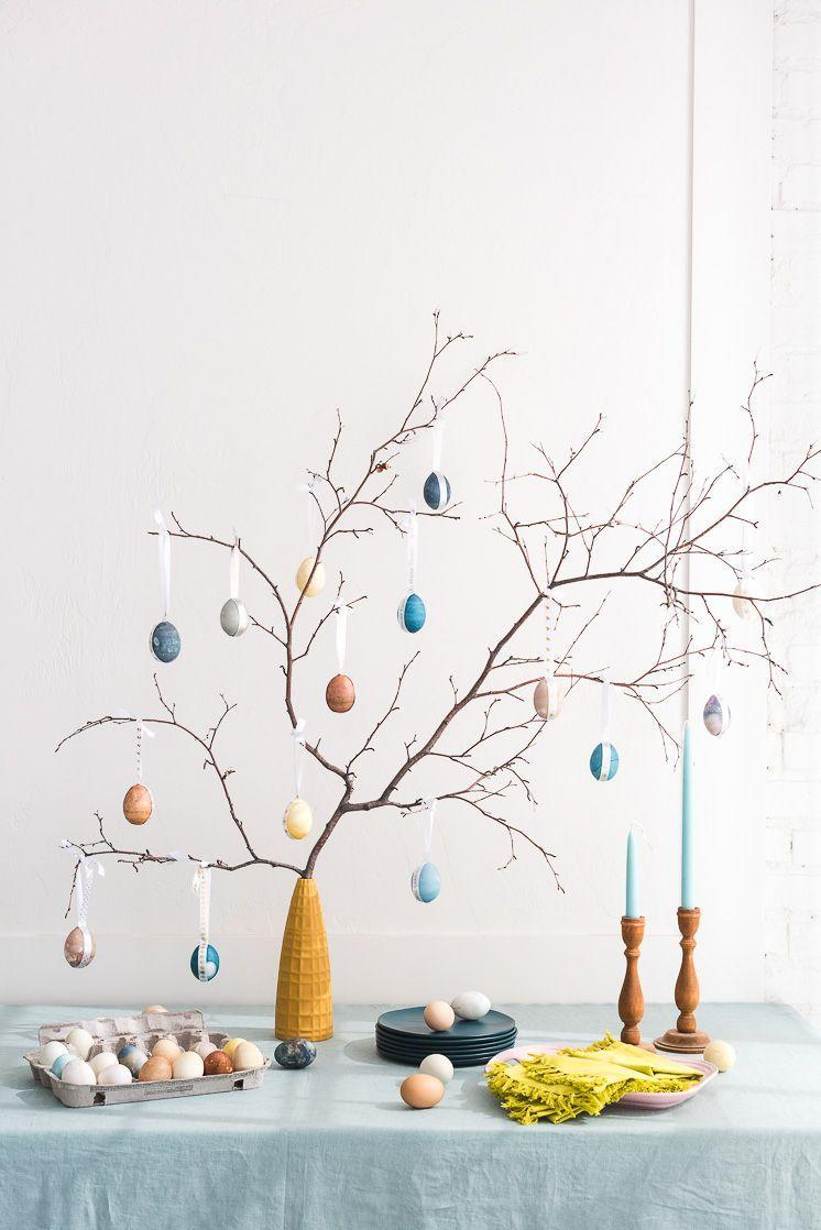 """<p>Love this tree's dreamy color palette? Look no further than your own fridge! The eggs were <a href=""""https://www.countryliving.com/diy-crafts/a42326/dyeing-easter-eggs/"""" rel=""""nofollow noopener"""" target=""""_blank"""" data-ylk=""""slk:naturally dyed"""" class=""""link rapid-noclick-resp"""">naturally dyed</a> using red onion, red cabbage, blueberries, blackberries, and turmeric.</p><p><strong>Get the tutorial at <a href=""""http://thehousethatlarsbuilt.com/2018/03/naturally-dyed-easter-egg-tree.html/#more-31813"""" rel=""""nofollow noopener"""" target=""""_blank"""" data-ylk=""""slk:The House That Lars Built"""" class=""""link rapid-noclick-resp"""">The House That Lars Built</a>.</strong></p>"""