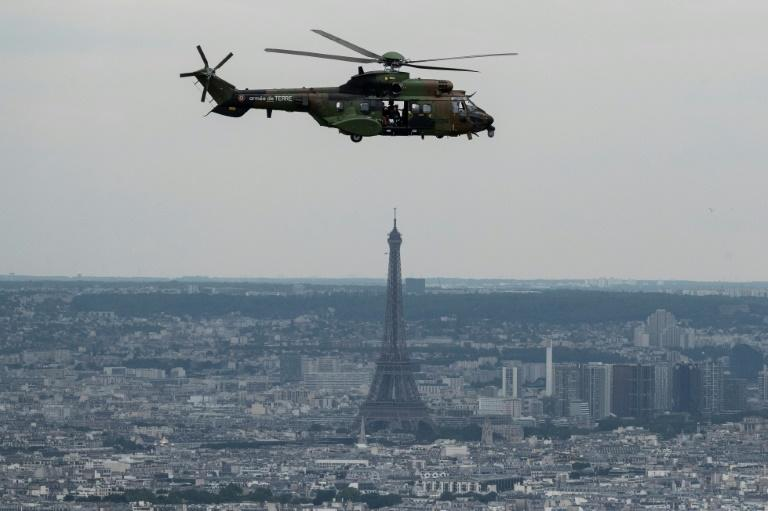 A French Eurocopter AS 532 Cougar flying during a rehearsal ahead of the Bastille day military air parade (AFP Photo/Kenzo TRIBOUILLARD)