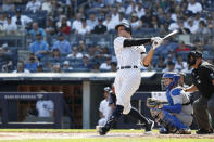New York Yankees' Aaron Judge hits a home run against the Toronto Blue Jays during the first inning of a baseball game, Sunday, Sept. 22, 2019, in New York. (AP Photo/Michael Owens)