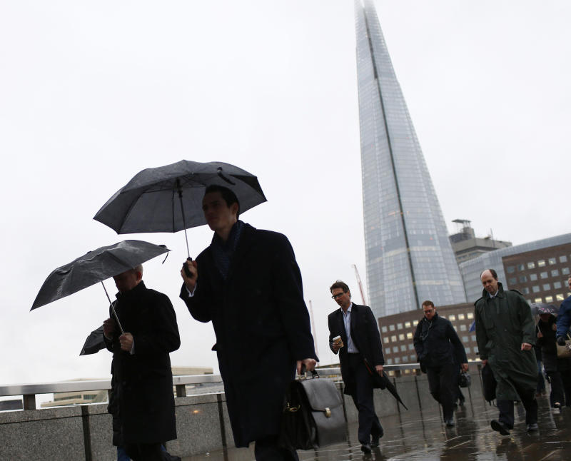 The Shard is seen as workers use umbrellas to shelter themselves from the rain while crossing London Bridge in London February 28, 2014. London's financial services sector created 25 percent more jobs in February than a year ago, new data has shown, indicating the industry may be recovering from the restructuring and redundancies prompted by the financial crisis. After a strong January, the City hiring market showed no signs of slowing down last month, with 3,220 new jobs created, compared with 2,575 added in February 2013, according to financial services recruiter Astbury Marsden. The data suggests London's banks and financial services companies are returning to growth after slashing thousands of jobs in the face of a lengthy recession and a series of industry scandals that followed the financial crisis. Picture taken February 28, 2014. REUTERS/Eddie Keogh (BRITAIN - Tags: BUSINESS EMPLOYMENT) ATTENTION EDITORS: PICTURE 10 OF 25 FOR PACKAGE 'CITY OF LONDON - LIFE IN THE SQUARE MILE'. TO FIND ALL IMAGES SEARCH 'RECRUITER KEOGH'