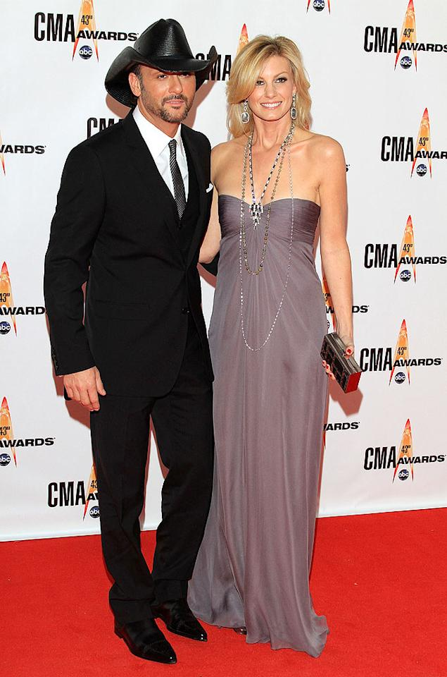 "Tim McGraw and Faith Hill  Grade: A-  Country music's royal couple ruled the red carpet. Tim donned a sleek and sophisticated suit, while Faith opted for a mauve maxidress and brilliant baubles. Taylor Hill/<a href=""http://www.wireimage.com"" target=""new"">WireImage.com</a> - November 11, 2009"