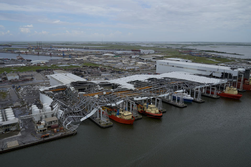 Damage to ship docking facilities are seen in the aftermath of Hurricane Ida in Port Fourchon, La., Tuesday, Aug. 31, 2021. (AP Photo/Gerald Herbert)