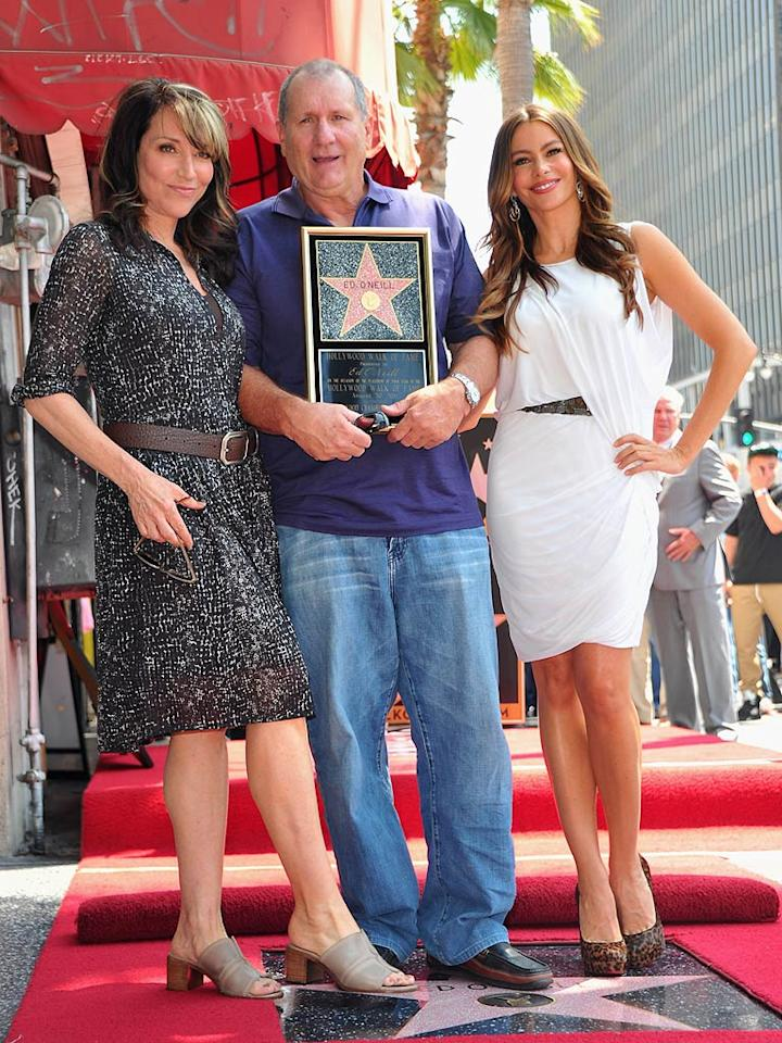 """Actor Ed O'Neill, 65, brought not one but <i>two</i> of his wives -- TV wives that is -- to his Hollywood Walk of Fame ceremony on Tuesday. Katey Sagal (left) played the wife of his infamous couch potato character Al Bundy for a whopping 11 seasons on """"Married With Children,"""" beginning in 1987. These days, sexy Sofia Vergara stars as his much younger spouse on the breakout hit """"Modern Family."""" Alberto E. Rodriguez/<a href=""""http://www.gettyimages.com/"""" target=""""new"""">GettyImages.com</a> - August 30, 2011"""