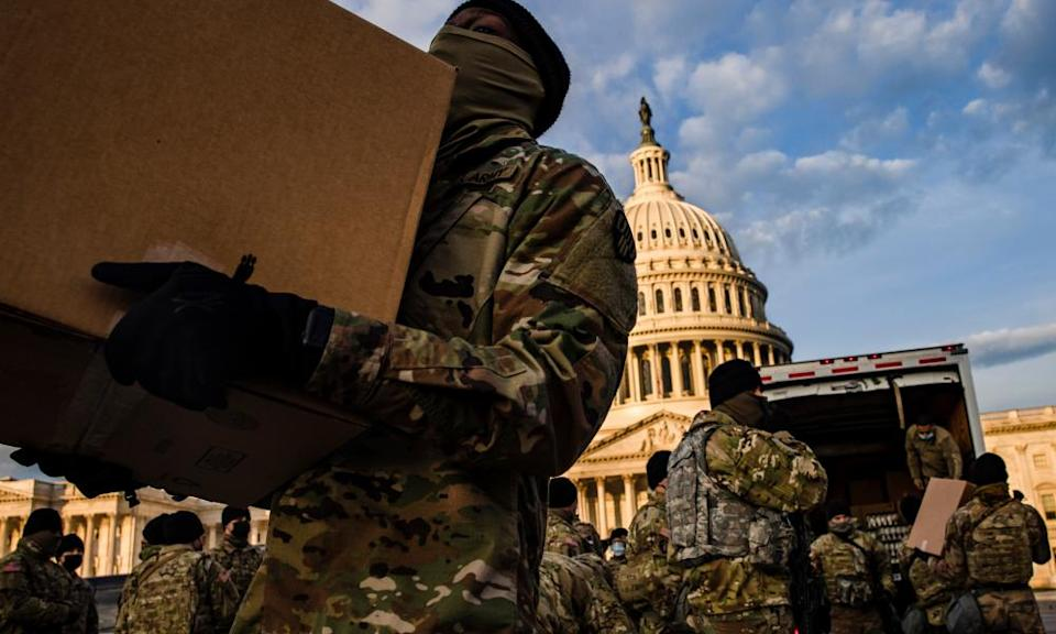 The National Guard prepare to protect Joe Biden's inauguration, as fears grow of attacks by the far-right.