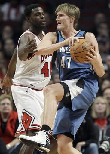 Minnesota Timberwolves forward Andrei Kirilenko (47) rebounds the ball against Chicago Bulls Nazr Mohammed (48) during the first half of an NBA preseason basketball game in Chicago, Friday, Oct. 19, 2012. (AP Photo/Nam Y. Huh)