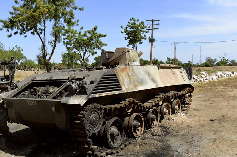 One of Boko Haram's tanks sits on November 12, 2014 in Amchide, after being destroyed by Cameroonian soldiers during an attack against the military base by the Islamic fighters (AFP Photo/Reinnier Kaze)