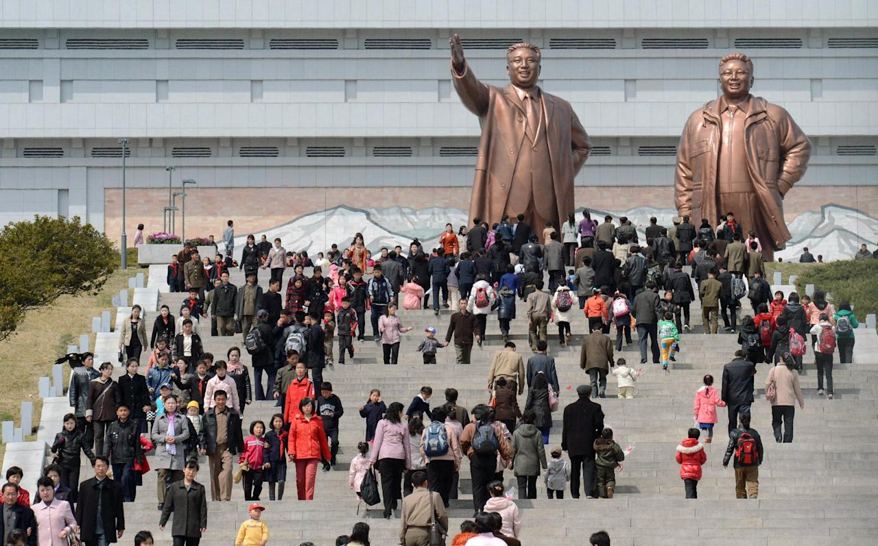 People visit giant statues of the late North Korean leaders, Kim Il Sung, left, and his son Kim Jong Il, in Pyongyang, North Korea, Monday, April 15, 2013. Oblivious to international tensions over a possible North Korean missile launch, Pyongyang residents spilled into the streets Monday to celebrate a major national holiday, the birthday of their first leader, Kim Il Sung. (AP Photo/Kyodo News) JAPAN OUT, MANDATORY CREDIT, NO LICENSING IN CHINA, HONG KONG, JAPAN, SOUTH KOREA AND FRANCE