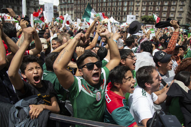 Wild scenes: Mexico fans go crazy in Mexico City's Zocalo Square as their side beat Germany. (PA)