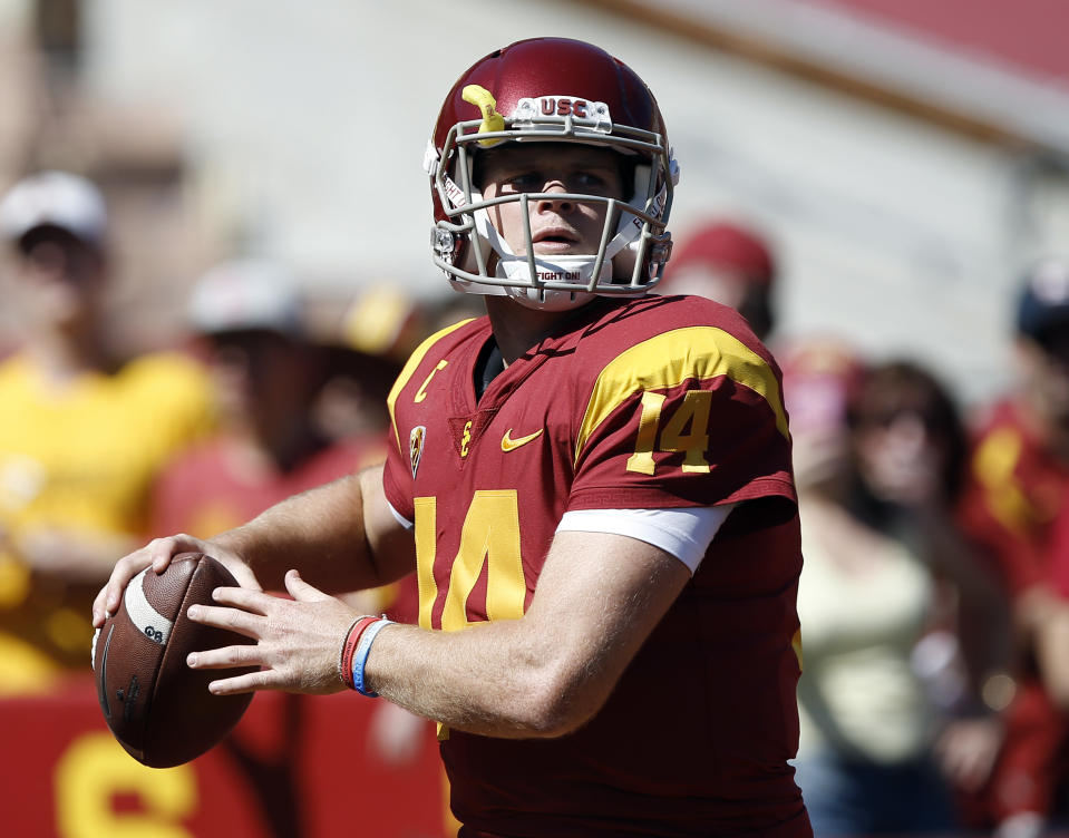 USC quarterback Sam Darnold warms up before an NCAA college basketball game against Oregon State. (AP)