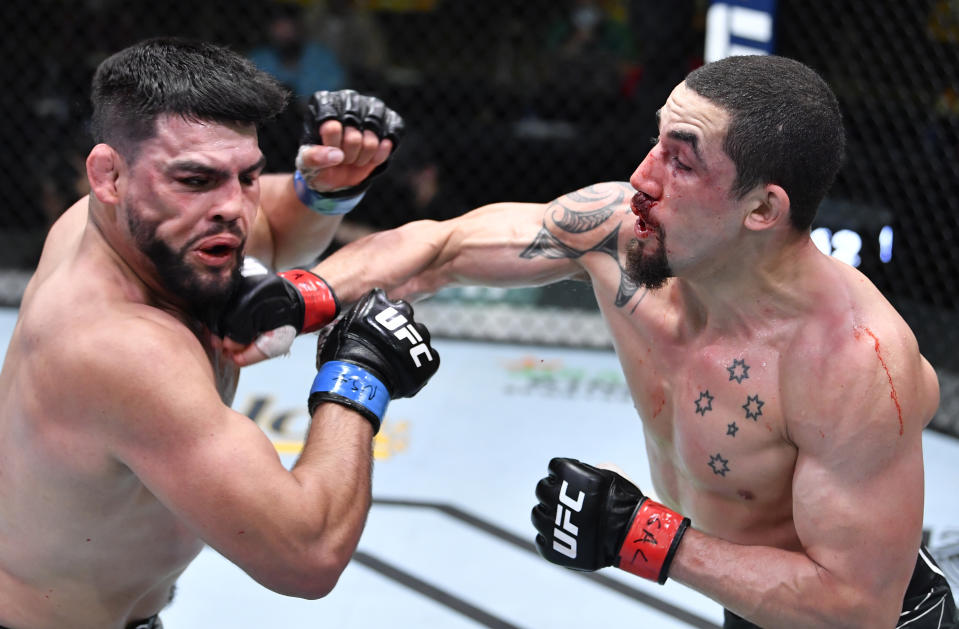LAS VEGAS, NEVADA - APRIL 17: (R-L) Robert Whittaker of Australia punches Kelvin Gastelum in a middleweight fight during the UFC Fight Night event at UFC APEX on April 17, 2021 in Las Vegas, Nevada. (Photo by Chris Unger/Zuffa LLC)
