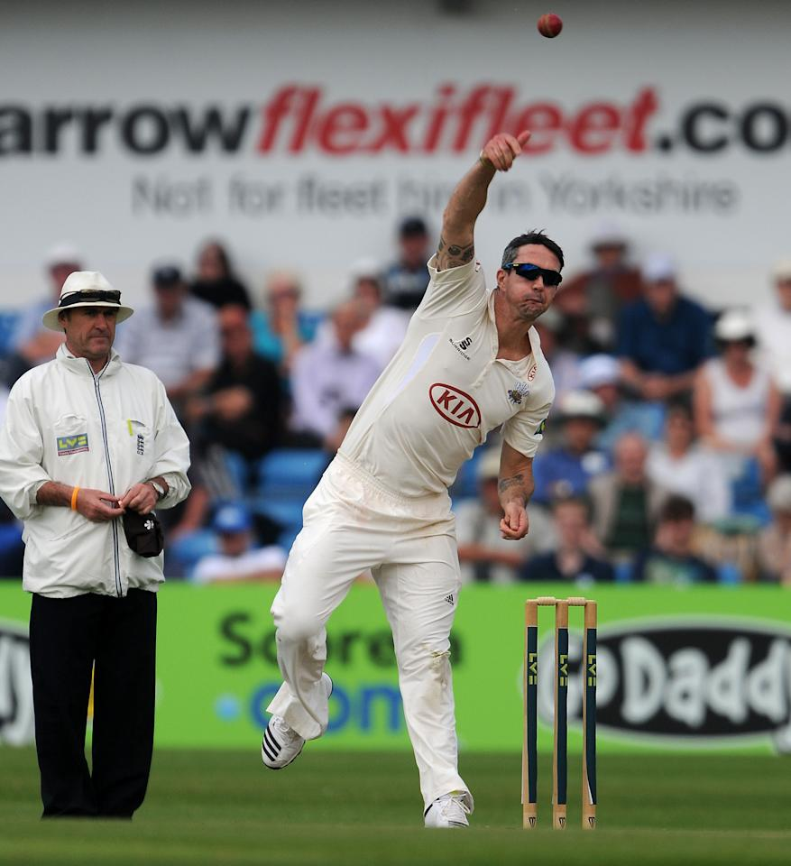 Surrey's Kevin Pietersen bowls during day one of the LV County Championship match at Headingley Cricket Ground, Leeds.