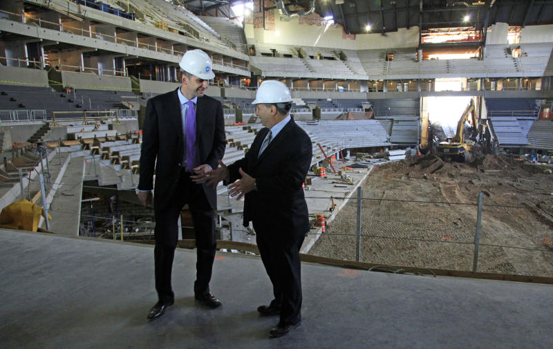Mikhail Prokhorov, left, Russian billionaire and owner of the New Jersey Nets basketball team,  and Bruce Ratner, developer of the Barclays Center arena, speak during a news conference on Tuesday, April 10, 2012 at the arena's construction site in the Brooklyn borough of New York.  (AP Photo/Bebeto Matthews)