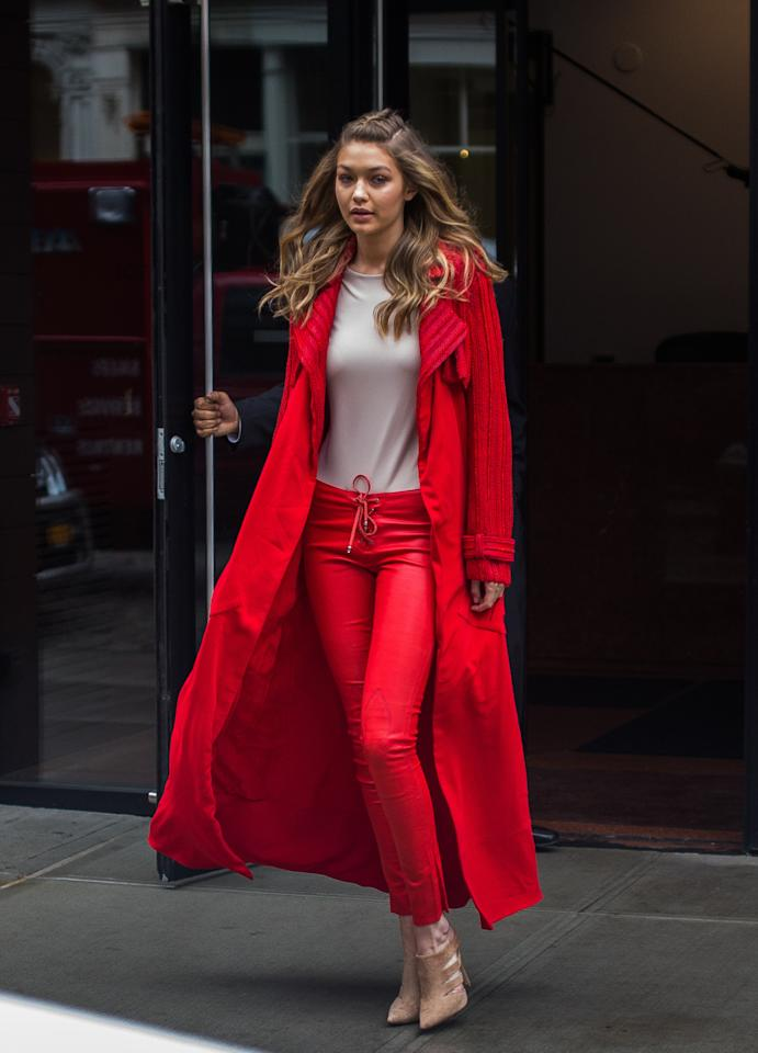 <p>Consider Gigi Hadid to have the exact opposite powers of <i>Frozen's </i>Elsa. Just a day after snow hit the ground, not a flurry was in sight when the model was spotted heading to an event for <i>Sports Illustrated </i>wearing red drawstring pants with a gray T-shirt and a Sally LaPointe Red Crepe Duster Trench Coat from the Spring 2016 collection. <i>Photo: Getty Images </i><br /></p>