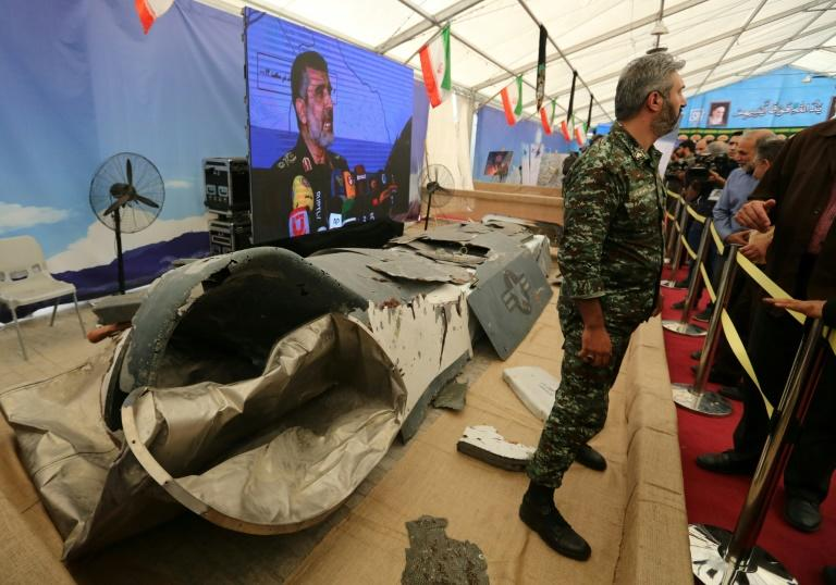Iran shows off what it says is the wreckage of a US drone it shot down over its territorial waters earlier this year at a new exhibition in Tehran's Islamic Revolution and Holy Defence museum