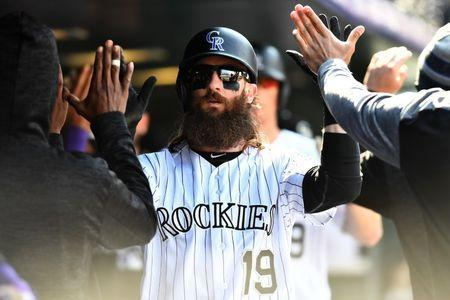 Sep 30, 2018; Denver, CO, USA; Colorado Rockies center fielder Charlie Blackmon (19) celebrates after scoring a run in the fifth inning against the Washington Nationals at Coors Field. Mandatory Credit: Ron Chenoy-USA TODAY Sports