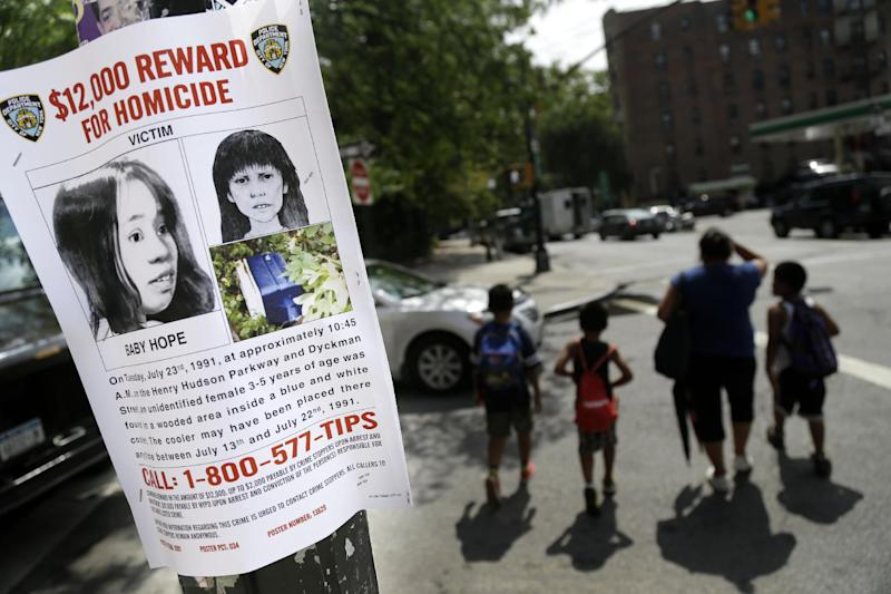 "This Tuesday, July 23, 2013, photo shows a poster soliciting information regarding an unidentified body near the site where the body was found in New York. More than two decades after the body of a child was found inside a cooler, the New York Police Department is seeking help identifying the girl dubbed ""Baby Hope."" On Tuesday, the 22nd anniversary of the discovery, police offered a $12,000 reward for any information leading to an arrest and conviction in the unsolved crime. (AP Photo/Seth Wenig)"