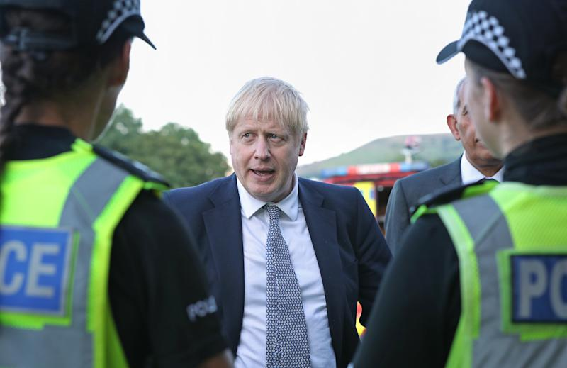 Prime minister Boris Johnson meeting police (Picture: PA)