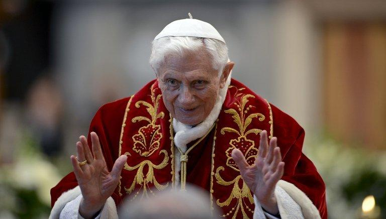 Pope Benedict XVI waves as he leaves after the mass in St.Peter's Basilica to mark the 900th anniversary of the Order of the Knights of Malta, on February 9, 2013 at the Vatican