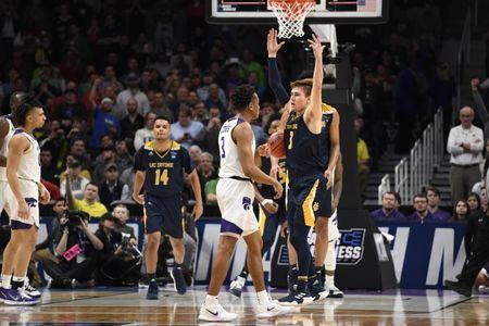 Mar 22, 2019; San Jose, CA, USA; UC Irvine Anteaters guard Robert Cartwright (3) and Kansas State Wildcats guard Kamau Stokes (3) react after the game in the first round of the 2019 NCAA Tournament at SAP Center. Mandatory Credit: Kelley L Cox-USA TODAY Sports