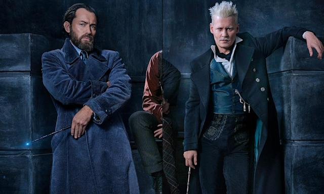 Jude Law as a young Dumbledore, with Johnny Depp as Grindelwald in the <em>Fantastic Beasts</em> sequel. (Photo: Warner Bros.)