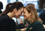 Jenny Morrison, right, wife of Australian Prime Minister Scott Morrison, receives a hongi from New Zealand Prime Minister Jacinda Ardern during a Powhiri (welcome ceremony) at a hotel in Queenstown, New Zealand, Sunday, May 30, 2021. Growing friction with China and how to reopen borders after the pandemic will likely be among the topics discussed by the leaders of Australia and New Zealand in their first face-to-face meeting since the coronavirus outbreak began. (George Heard/NZ Herald via AP)