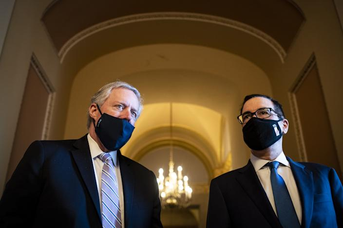 Mark Meadows, White House chief of staff, left, and Steven Mnuchin, U.S. Treasury secretary, wear protective masks while speaking to members of the media after a meeting with Senate Majority Leader Mitch McConnell, a Republican from Kentucky, not pictured, at the U.S. Capitol in Washington, D.C., U.S., on Thursday, July 23, 2020. (Al Drago/Bloomberg via Getty Images)