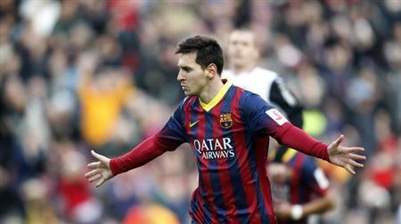 Barcelona's Lionel Messi celebrates scoring against Valencia during their Spanish first division soccer match at Camp Nou stadium in Barcelona February 1, 2014. REUTERS/Albert Gea