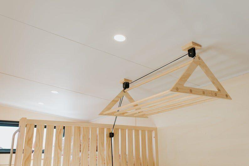 """This pulley rack can be used in small spaces with high ceilings to dry clothes. <strong><a href=""""https://fave.co/2MLvZWh"""" target=""""_blank"""" rel=""""noopener noreferrer"""">Get it on Etsy, $115</a></strong>."""