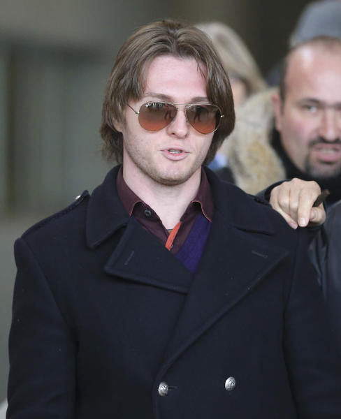 FILE - In this Thursday, Jan. 30, 2014 file photo, Raffaele Sollecito leaves after attending the final hearing before the third court verdict for the murder of British student Meredith Kercher, in Florence, Italy. An Italian court that convicted Amanda Knox in her roommate's 2007 murder says the wounds indicate multiple aggressors, and that the two exchange students fought over money the night of the murder. The appellate court in Florence on Tuesday, April 29, 2014, issued a 337-page explanation for its January guilty verdicts against the American and her former boyfriend Raffaele Sollecito. The release of the court's reasoning opens the verdict to an appeal back to the supreme Court of Cassation. If it confirms the convictions, a long extradition fight for Knox is expected. She has been in the United States since 2011 when her earlier conviction was overturned. British student Meredith Kercher, 21, was found dead in a pool of blood in the apartment she and Knox shared in the town of Perugia. (AP Photo/Antonio Calanni, File)