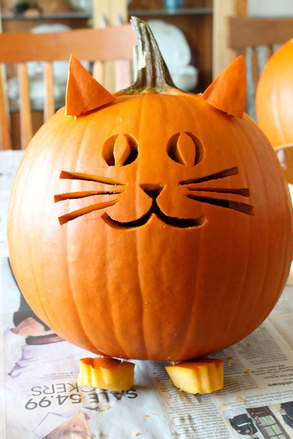 "<p>There's nothin' scary about this adorable little pumpkin!</p><p><strong>Get the tutorial at <a href=""http://ladyfaceblog.blogspot.com/2013/10/pumpkin-carving.html"" rel=""nofollow noopener"" target=""_blank"" data-ylk=""slk:Ladyface Blog"" class=""link rapid-noclick-resp"">Ladyface Blog</a>. </strong></p>"