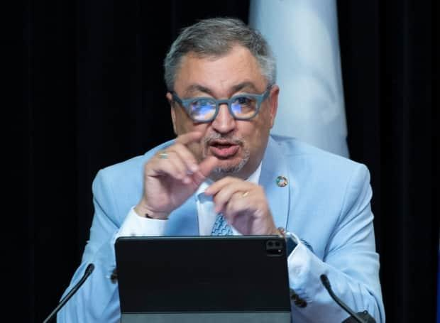 Dr. Horacio Arruda, Quebec's director of public health, defended the decision to gather personal information and said it would be destroyed at the end of the year. (Jacques Boissinot/The Canadian Press - image credit)