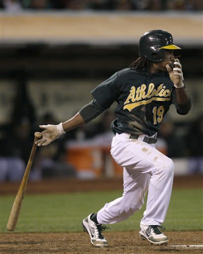 Oakland Athletics' Jemile Weeks (19) singles to score Brandon Hicks during the eighth inning of a baseball game against the Seattle Mariners in Oakland, Calif., Friday, July 6, 2012. (AP Photo/Jeff Chiu)