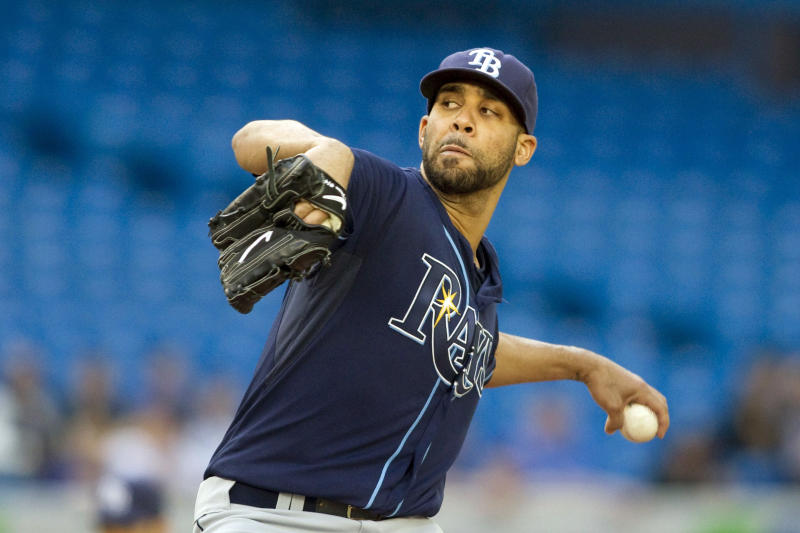 Tampa Bay Rays starting pitcher Henderson David Price works against Toronto Blue Jays during the first inning of a baseball game, Tuesday, May 15, 2012, in Toronto. (AP Photo/The Canadian Press, Chris Young)