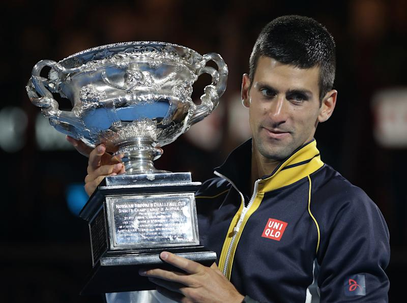 Serbia's Novak Djokovic holds his trophy after defeating Britain's Andy Murray in the men's final at the Australian Open tennis championship in Melbourne, Australia, Sunday, Jan. 27, 2013. (AP Photo/Dita Alangkara)