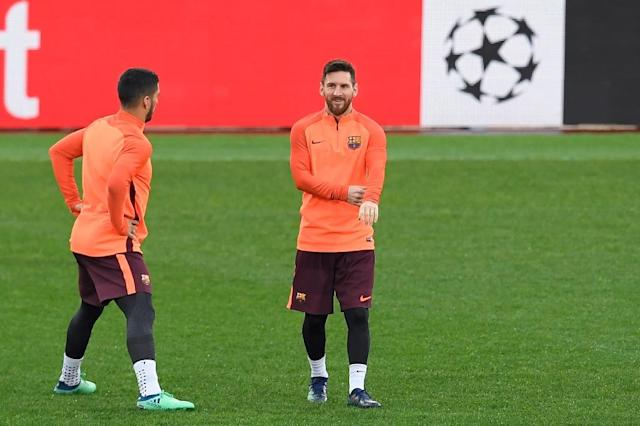 Lionel Messi (R) and Luis Suarez, both seen during a training session at the Olympic Stadium in Rome, are set to support a joint bid from Argentina, Uruguay and Paraguay to host the 2030 centenary World Cup (AFP Photo/LLUIS GENE)