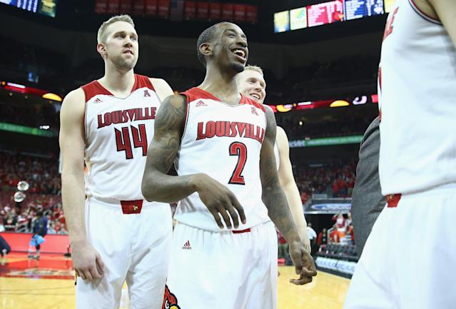 LOUISVILLE, KY - MARCH 08: Russ Smith #2 of the Louisville Cardinals celebrates with teammates after the game against the Connecticut Huskies at KFC YUM! Center on March 8, 2014 in Louisville, Kentucky. It was senior day and it was Smith's last home game. (Photo by Andy Lyons/Getty Images)