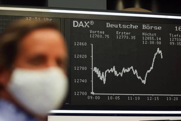 Stock markets around the world fell on Monday morning as rising case numbers of the coronavirus that causes COVID-19 reminded investors the situation is still far from normal. (Alex Kraus/Bloomberg - image credit)