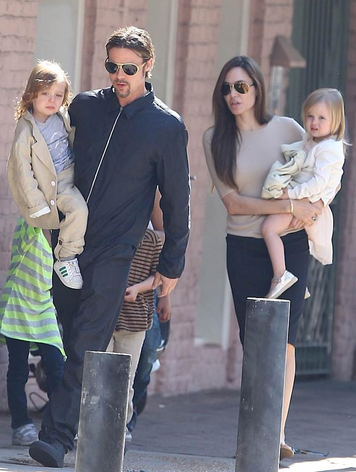 """<i>In Touch</i> reports that after Angelina Jolie and her six children visited Brad Pitt on the New Orleans set of """"Cogan's Trade,"""" he sent her packing because she """"overstayed her welcome."""" According to the <i>Enquirer</i>, Pitt felt Jolie was unfairly """"checking up on him"""" to make sure he wasn't flirting with other actresses, and so the annoyed actor had """"no other choice but to ask her to leave."""" For how bad it's become between Pitt and Jolie, check out the full story at <a href=""""http://www.gossipcop.com/brad-pitt-new-orleans-angelina-jolie-cogans-trade/"""" target=""""new"""">Gossip Cop</a>. <a href=""""http://www.splashnewsonline.com"""" target=""""new"""">Splash News</a> - March 20, 2011"""