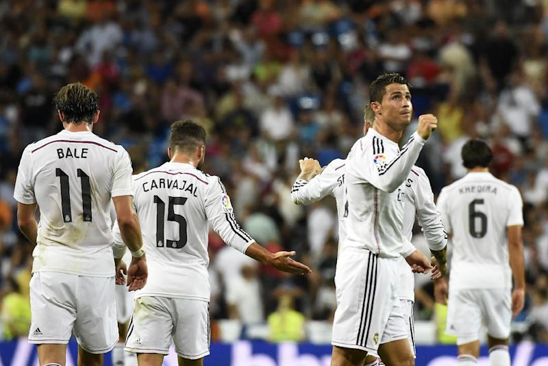 Real Madrid's Cristiano Ronaldo celebrates with teammates after scoring during the La Liga match against Cordoba CF at Santiago Bernabeu stadium on August 25, 2014 (AFP Photo/Gerard Julien)