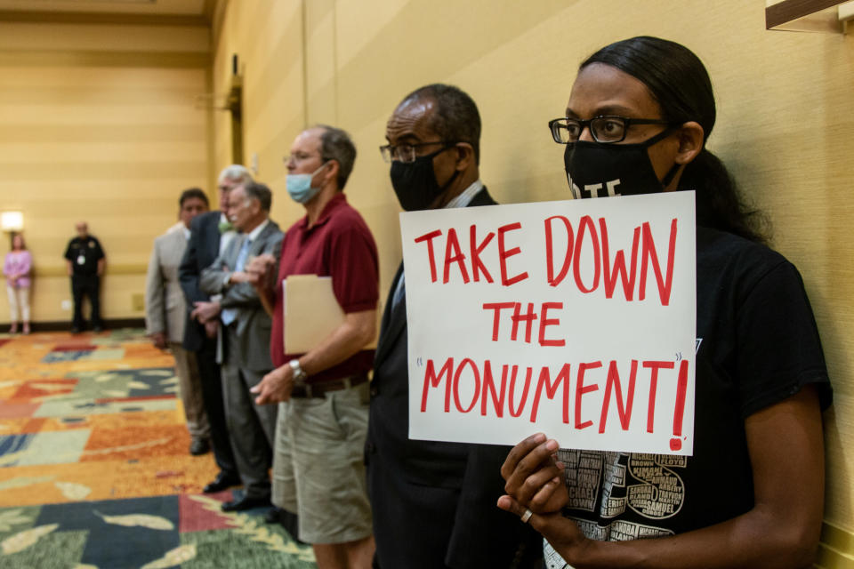 People attend a meeting of the Stone Mountain Memorial Association Monday, May 24, 2021, in Stone Mountain, Ga. The Stone Mountain Memorial Association board approved some minor changes in the popular Confederate-themed park, located near Atlanta, but did not address any possible changes to the carving or streets named after Confederate generals as some had hoped. (AP Photo/Ron Harris)