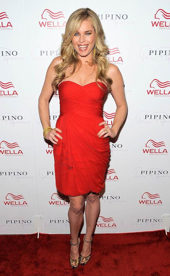 """Rebecca Romijn also opted for a sassy red frock, which she paired with metallic strappy heels, at the grand opening of the first Wella salon in North America. Jerry O'Connell is one lucky guy! Jemal Countess/<a href=""""http://www.gettyimages.com/"""" target=""""new"""">GettyImages.com</a> - May 17, 2011"""